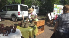 Master works clay on a potter's wheel Stock Footage