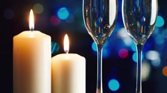 Christmas candle and two glasses of champagne. The celebration of Christmas and Stock Footage
