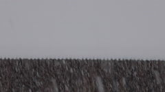 Slow motion of heavy snow on a country house backdrop in a mountain village Stock Footage