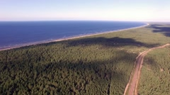Aerial view to the baltic sea over forest in Latvia Stock Footage