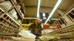 4K UHD Footage Man With Trolley Walks Between Rows in Supermarket Stock Footage