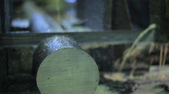 sawed-off piece of metal, which lies on the machine clamped in a vise and band - stock footage