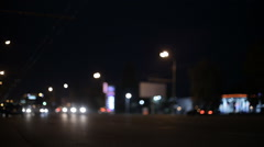 Stock Video Footage of cars moving through the city at night in real-time shot without focus
