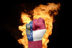 Fire fist with the flag of georgia Stock Photos