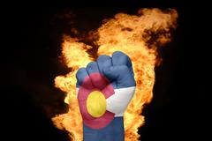 Fire fist with the flag of colorado Stock Photos