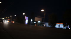 The flow of cars moving at night in real-time shot without focus Stock Footage
