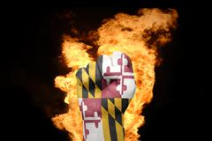 fire fist with the flag of maryland - stock photo
