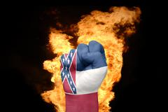 Fire fist with the flag of mississippi Stock Photos