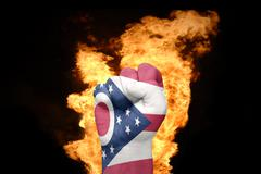 fire fist with the flag of ohio - stock photo
