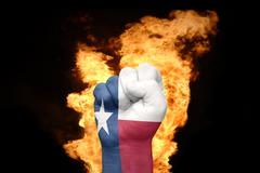 fire fist with the flag of texas - stock photo