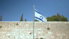 Israeli flag in the wind, Wailing Wall, Jerusalem, Israel Stock Footage