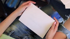 Girl Opens The Card. Happy Valentine's day Written in The card. Stock Footage
