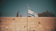 Israeli flag in the wind, Wailing Wall, Jerusalem, Israel Stock Footage