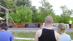 Spectators watching drag race start line 4K Stock Footage