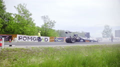Dragster driving backwards to the start line 4K Stock Footage