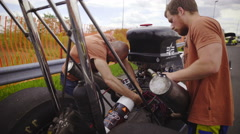 Two person fix Dragster jib shot 4K Stock Footage