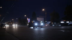 Stream of cars on the Autobahn at night with headlights Stock Footage
