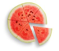 Round ripe watermelon with extended sector - stock photo