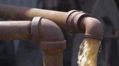 Water pump pipe cycled by old engine Stock Footage
