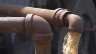 Stock Video Footage of Water pump pipe cycled by old engine