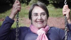 Elder woman on a swing - stock footage