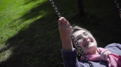 Elder woman on a swing Stock Footage
