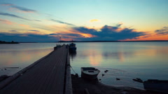 Tranquil Sunrise on Lake With Wooden Pier Stock Footage