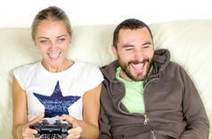 Couple play videogames - boy encourages his girlfriend while playing video ga Kuvituskuvat