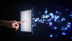 Man using a digital tablet with holographic icons flying from it. Blue. - stock footage