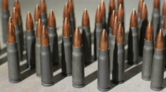 AK47 Bullets standing up, dolly shot Stock Footage