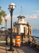 The Statue of Liberty tour cruise ship at Ellis Island Stock Photos