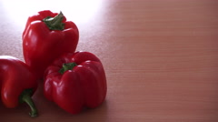 Red bell peppers on kitchen table 4K Stock Footage