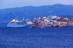 Stock Photo of Agios Nikolaos City and Cruse Ship at Night, Crete, Greece