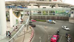 Pedestrian overpass bridge above noisy junction, city traffic, modern urban view Stock Footage