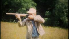 2524 - a hunter with his new rifle - vintage film home movie Stock Footage