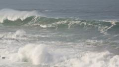 Huge storm surf waves breaking onto the coast Stock Footage