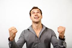 Win or succes concept - man happy for his luck Stock Photos