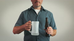 4K: Man Pours Beer Into Frosty Mug Stock Footage