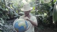 Stock Video Footage of Man in the jungle with globe