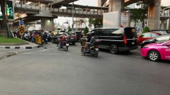 Mixed vehicles stream start on green traffic light, modern urban area Stock Footage