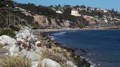 Wild stone shore or coast with waves of the Pacific ocean on Malibu, California Stock Footage