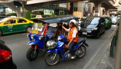Motorcycle taxi driver talk with tuk-tuk passengers and cabby, stand on driveway Stock Footage