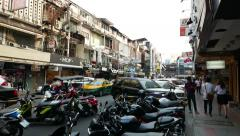 Siam Square 2 alley full of parked motorcycle, POV camera walk along footpath Stock Footage
