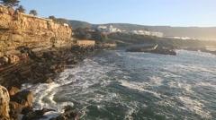 Waves breaking against rocky sea cliffs at Hermanus Stock Footage