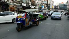 Car and tuk-tuk vehicles stand in queue waiting to exit local parking lot Stock Footage