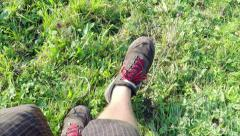 Hiking shoes close up outdoors. Down the hill. Stock Footage