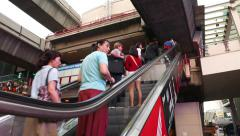 Asian pedestrians travelling up on escalator, to Siam BTS concourse level Stock Footage
