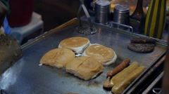 Cooking Fried Sausages and Fast Food Hamburger Roll on Street Stock Footage