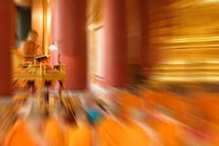 Blurred zoom of Thai monk worship in temple - stock photo