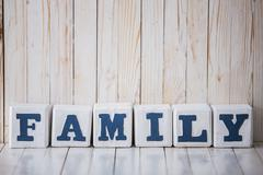 Stock Photo of FAMILY sign made of wooden blocks on wooden background